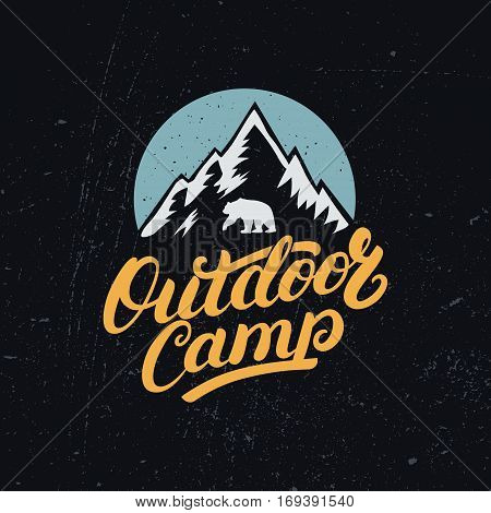 Outdoor Camp hand written lettering with mountains and bear silhouette. Vintage tee print, logo, label, badge, emblem. Vector illustration.