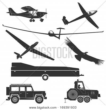 Set of vintage gliding elements and equipment. Vector illustration. Set include glider winches, eagle, gliding trailer, airplane and glider plane silhouette.