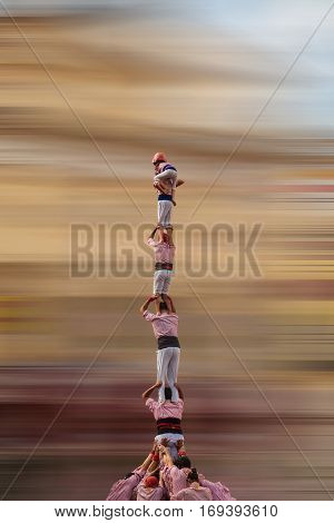 catalan human towers. tradtional perfomance. motion blur background