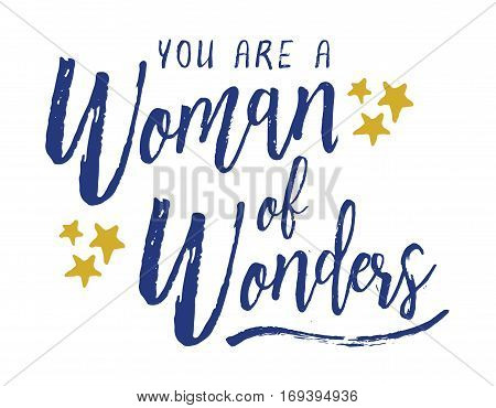 You are a Woman of Wonders. Brush Script Typography Design Art poster with blue letters, gold stars, blue underline swash on white background.