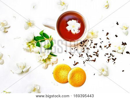 Tea Cup With Dried And Fresh Jasmine Flower And Biscuits