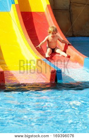 Cute Baby Boy Rides From Waterslide