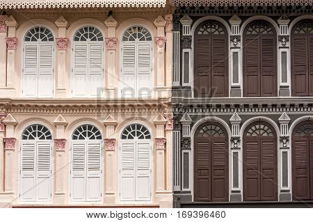 Contrasting, pink and brown, ornate building facades, in China Town, Singapore, Asia, with detailed archways for each window
