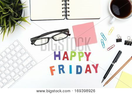 Office desk table with supply pen pencil notebook computer eye glasses sticky note cup of coffee and happy friday word on white background