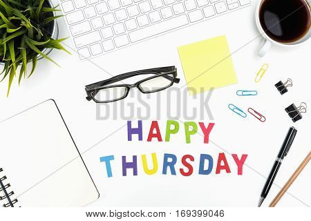 Office desk table with supply pen pencil notebook computer eye glasses sticky note cup of coffee and happy thursday word on white background