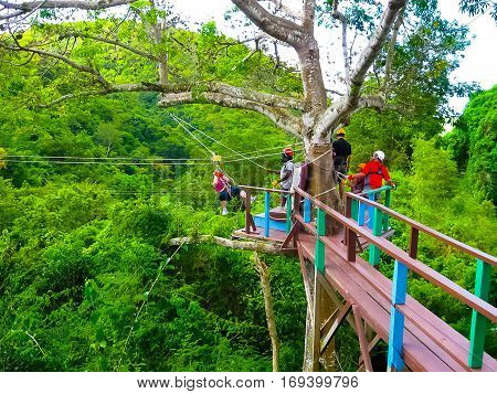 Woman going on a jungle zipline adventure at Antigua rainforest
