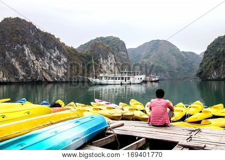young traveler relaxing meditation in halong bay and enjoy the beauty of seascape. Young love wild life travel freedom