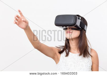 Woman play game though VR device