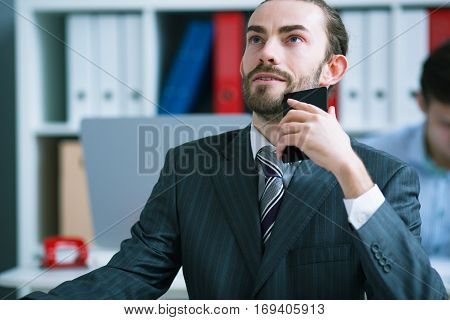 Businessman ponders last conversation took place on the phone
