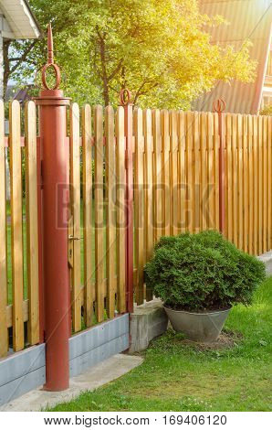 brick and mettal fence in a country house