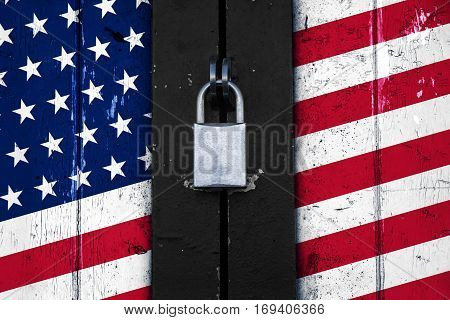 United states of america flag painted on a wooden door and locked with a padlock political concept background symbol for protectionism
