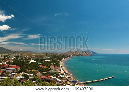 Panorama of the resort town of Sudak in the Crimea. Beautiful summer marine landscape. Travel photos