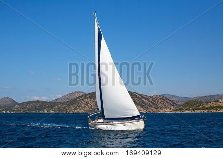 Luxury yachts. Sailing ship boats with white sails in the Sea.