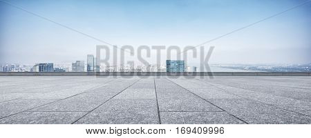 cityscape and skyline of hangzhou new city from brick floor