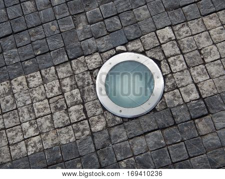 Roung Light In A Cobble Stone Pavement