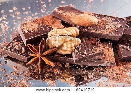Chocolate Pieces Walnut, Almond, Chocolate Shavings, Cocoa Powder, Anise Star