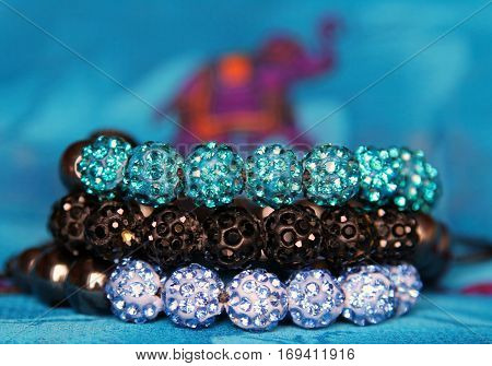 shining jewels on a background of Indian pattern