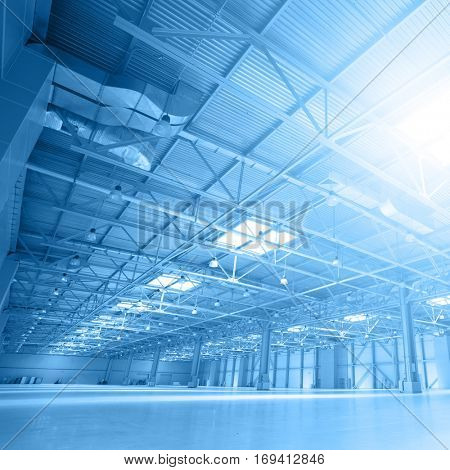 Angle shot of a storehouse with skylights. Toned image