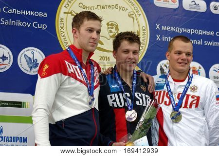 ST. PETERSBURG, RUSSIA - DECEMBER 17, 2016: Winners of X Salnikov Cup in 200 m freestyle swimming Aleksandr Krasnykh (center), Viacheslav Andrusenko (left) and Daniil Pasynkov, all from Russia