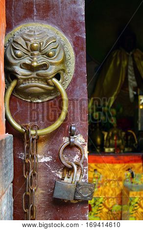 Entrance door of ancient taoist temple China