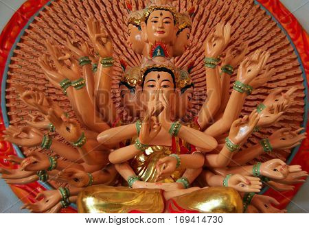 Statue of Quan Am with 1000 eyes and 1000 hands (or GuanyinGoddess of Mercy) in buddhist temple Da Lat Vietnam