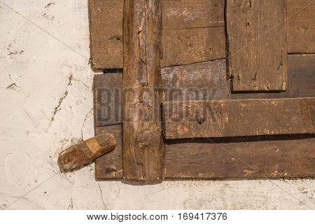 Wooden latch for an old window detail locks Wood with signs of wood worm