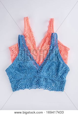 Women's Lace Bras in Coral and Blue Color on Grey Background