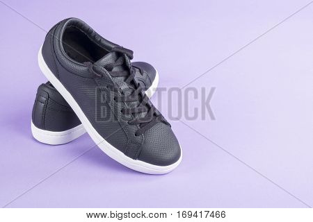 Causal Black Leather Shoes on Purple Background