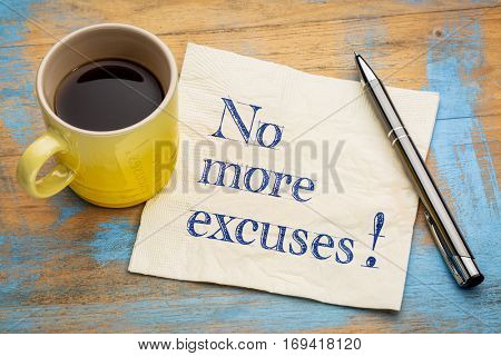 No more excuses! A motivational handwriting on a napkin with a cup of espresso coffee