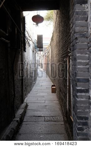 XITANG - FEBRUARY 20: Old narrow street in Chinese water village Xitang. It is one of six destination ancient Town, located in Zhejiang Province, China, February 20, 2016.
