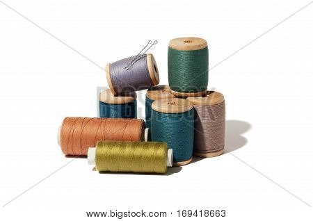 Spool of thread and needle isolated on white background.