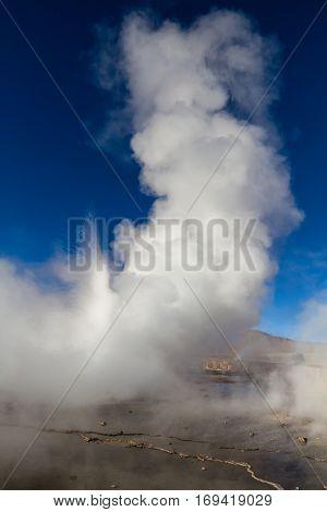 Eruption of geyser at El Tatio Atacama Desert Chile
