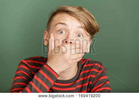 Boy Shocked Covering His Mouth