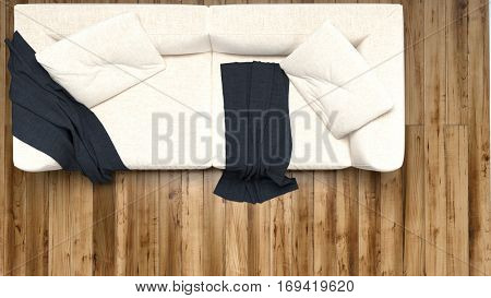 Overhead view of a vacant comfortable cream colored couch with black throw rugs on a hardwood floor. 3d Rendering.
