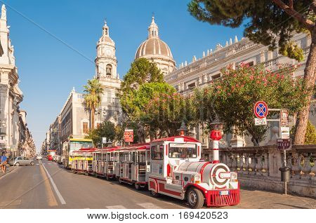 Excursion Steam Train In The Background Of The Cathedral In Catania