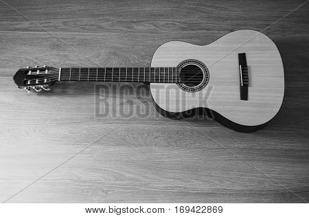 Guitar on wooden background fretboard, items for art