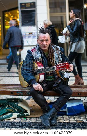 PORTO, PORTUGAL - DEC 9, 2016: Unidentified street musician on the one of the streets in the historical centre of Porto old town. City of Porto won the European Best Destination 2012 and 2014 awards.