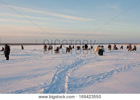 Fisherman enjoying a days fishing on the ice