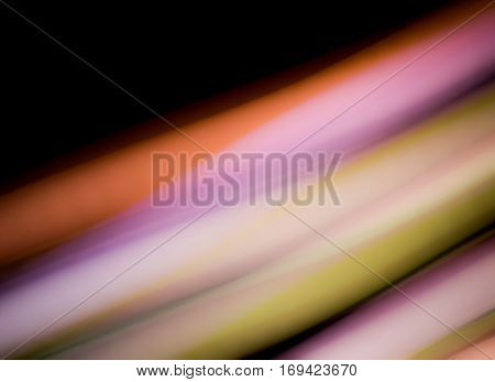 diagonal streaks of light in pastel pink, chartreuse and orange