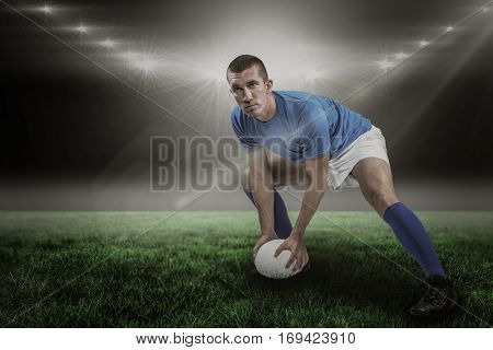 Confident rugby player playing against spotlight and copy space 3d