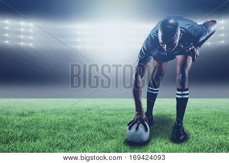Rugby player taking position against spotlight and copy space 3d