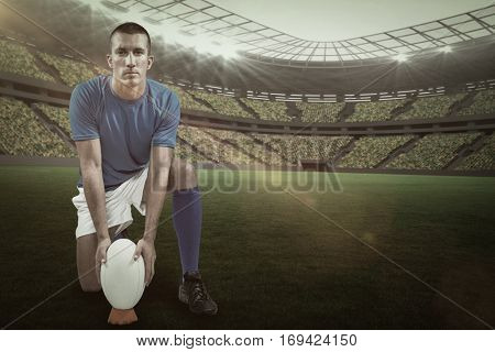 Full length portrait of rugby player placing ball against rugby stadium with copy space 3d