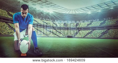 Full length of rugby player placing ball against rugby stadium with copy space 3d