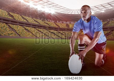 Rugby player holding ball while kneeling against rugby stadium with copy space 3d
