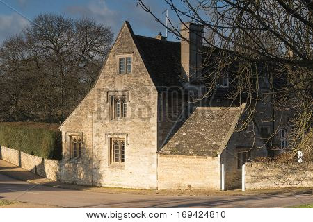 An image of a 17th century country house shot on a sunny day in winter in a picturesque village in Northamptonshire England UK