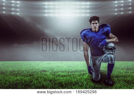 Portrait of serious sportsman holding helmet against spotlight with copy space 3d
