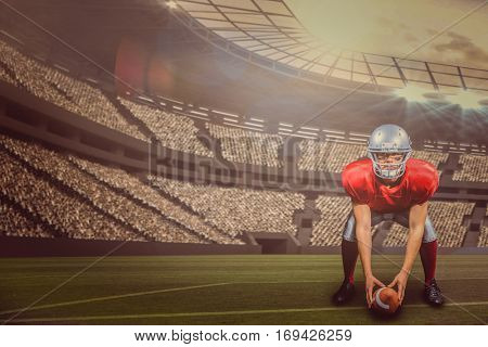 American football player bending while holding ball against large football stadium with lights with copy space 3d