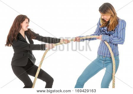 Two business woman pulling at a rope isolated at white background