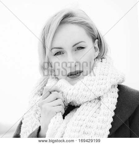 Young girl with juicy lips touching her cheeks, and looking into camera. Flirting with photographer