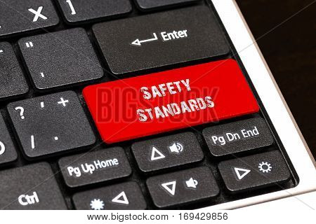 On The Laptop Keyboard The Red Button Written Safety Standards